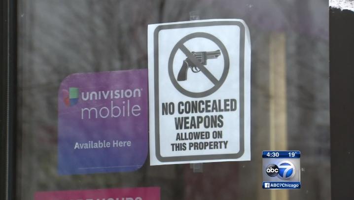 Chicago T-Mobile Gun-free zone sign 01132016